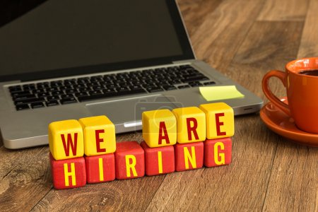 We Are Hiring written on  cubes