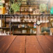 Empty table and blurred kitchen background, produc...