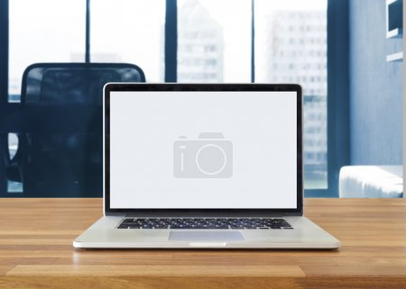 Photo for Laptop on table, on office background,blank screen - Royalty Free Image