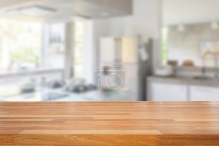 Empty wooden table and blurred kitchen background,...