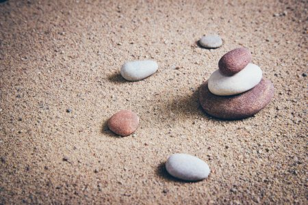 Photo for Zen garden sand waves and rock sculptures. Vintage photography effect. Retro grainy color film look. - Royalty Free Image