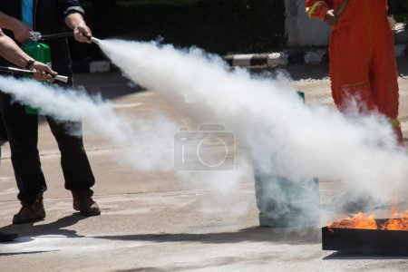 Instructor showing how to use a fire extinguisher on a training