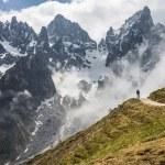Hikers on mountain trail, European Alps....