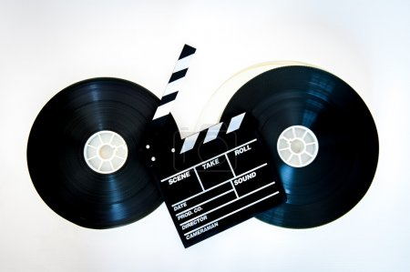 Movie clapper board on two 35 mm film reels