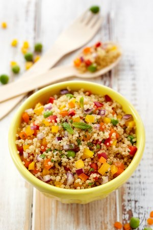 Photo for Quinoa salad with addition of pepper, red onion, green peas and fresh mint,  healthy and nutritious vegan dish - Royalty Free Image