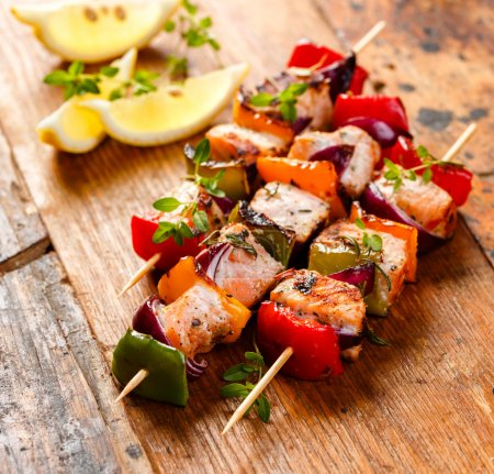 Grilled skewers of salmon and vegetables