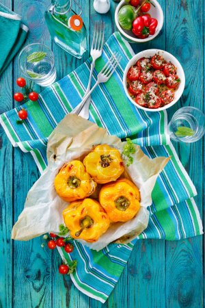 Roasted yellow bell  peppers stuffed with quinoa, mushrooms and cheese. Cherry tomatoes baked with parmesan