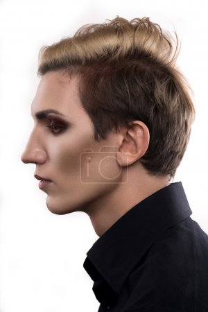 Androgynous male fashion model looking away