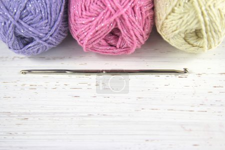 Yarn Wool pastel colours with crochet hook and copy space
