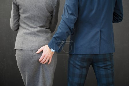 Co-worker touching woman's butt