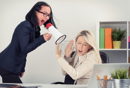 Mad boss shouting at employee on megaphone