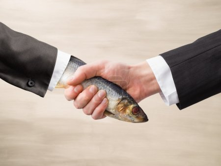Photo pour Dead Fish Handshake, men's business handshake - image libre de droit