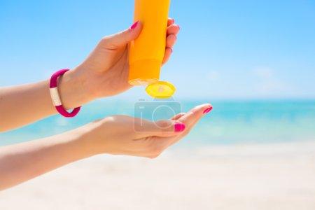 Woman using sunscreen