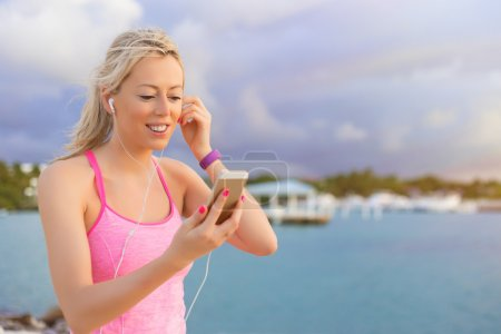 Fit woman listening to music while working out