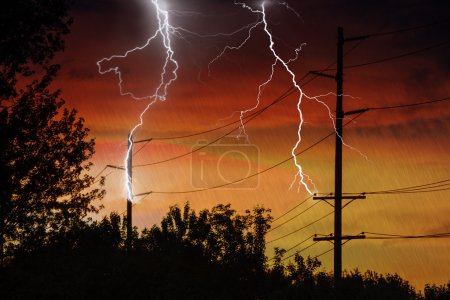 Photo for Silhouette of Power Lines being struck by lightning. - Royalty Free Image