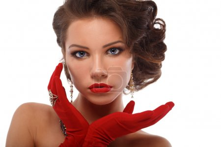Isolated Beauty Fashion Glamorous Model Girl Portrait. Vintage Style Mysterious Woman Wearing Red Glamour Gloves.