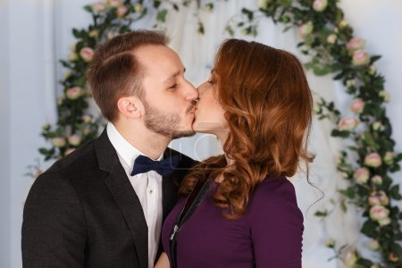 Young affectionate couple kissing.Young man kisses his beautiful girlfriend