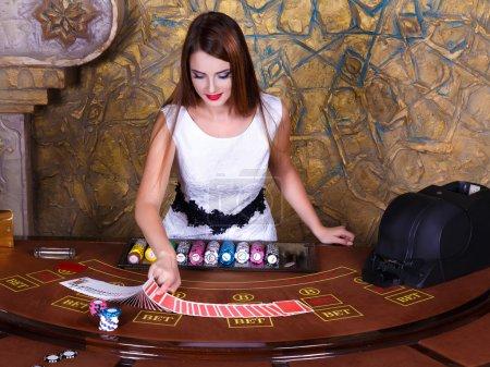 dealer at poker table