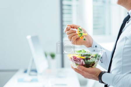 Photo for Businessman having a vegetables salad for lunch, healthy eating and lifestyle concept, unrecognizable person - Royalty Free Image