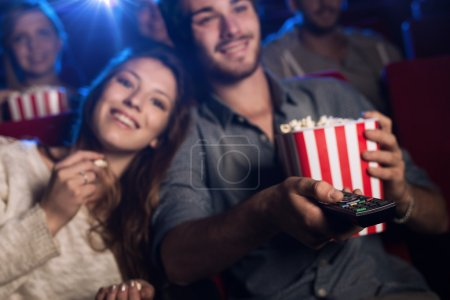 Young man watching a movie with his girlfriend