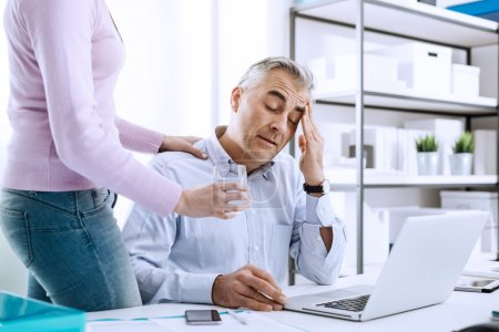 Businessman having an headache