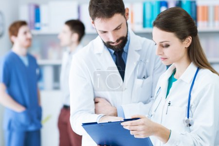 Doctors in the office checking patient's medical records