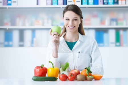 Smiling nutritionist in her office