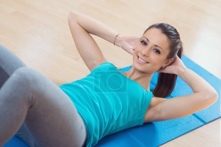 Woman doing abs workout at gym