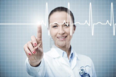 Female doctor using a touch screen interface