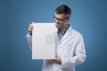 Confident doctor holding a sign