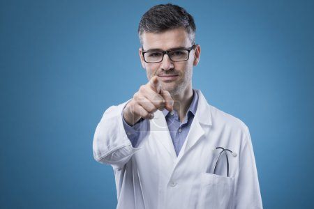 Confident doctor pointing