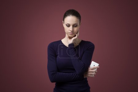 Sad woman with mobile phone