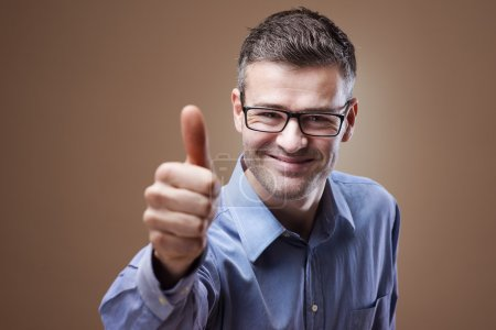 Photo for Smiling confident man thumbs up looking at camera - Royalty Free Image