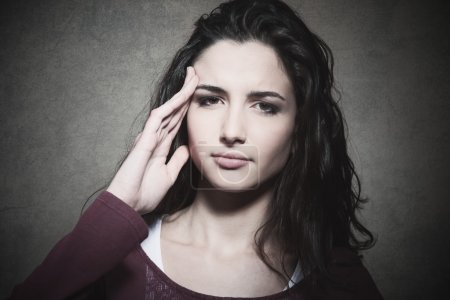 Tired young woman with headache