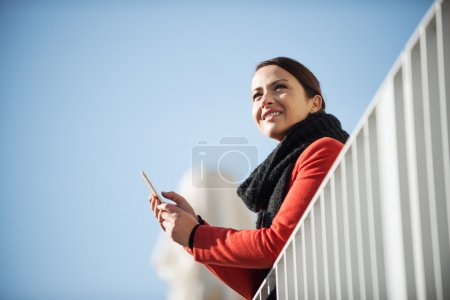Smiling woman on a terrace