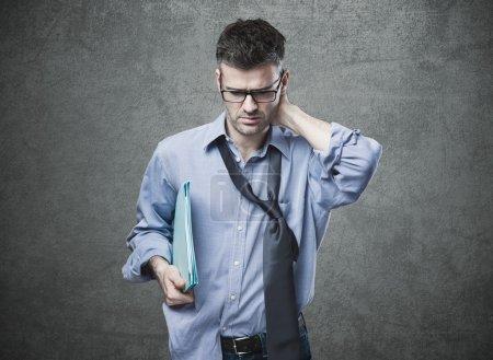 Confused untidy businessman