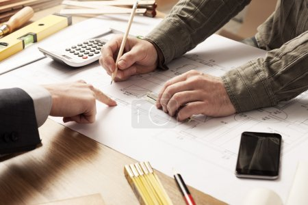 Photo for Businessman and construction engineer working together, the customer is pointing on the project on the desk - Royalty Free Image