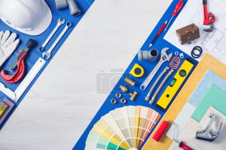 Photo for Home improvement and repair concept, plumbing work tools, tap, tiles and color swatches top view - Royalty Free Image