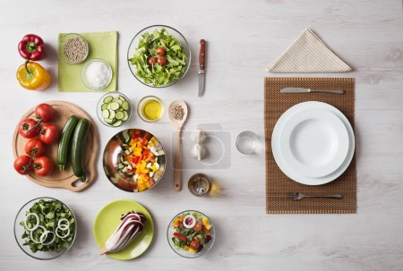 Photo for Healthy vegetarian meal concept with table set and fresh raw vegetables - Royalty Free Image
