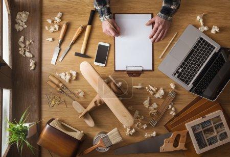 Man sketching a DIY project at home