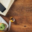 White scale, apple wrapped in a tape measure, towe...