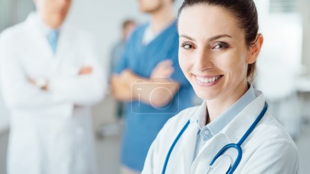 Professional female doctor posing and smiling