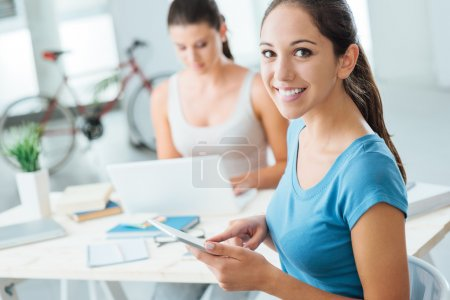 Girls using new technologies at home