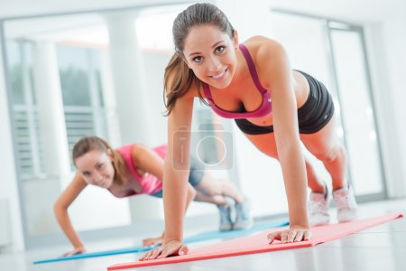 Girls doing push ups at the gym
