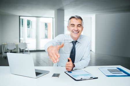 Photo for Smiling confident businessman giving an handshake, agreement and recruitment concept - Royalty Free Image