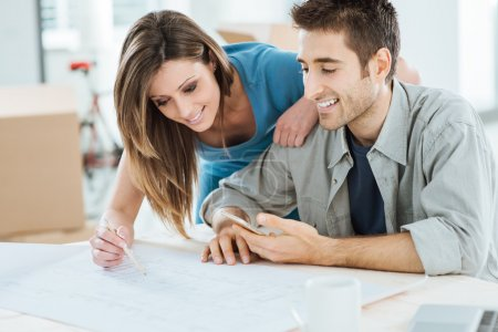 Couple designing their new house