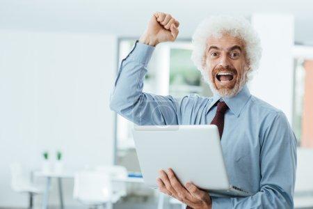 Cheerful businessman receiving good news