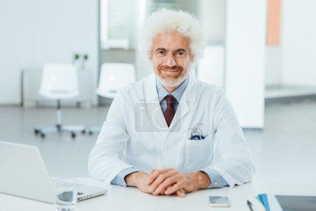 Doctor at desk posing
