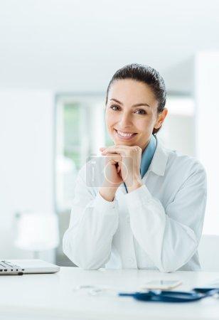 Beautiful female doctor posing