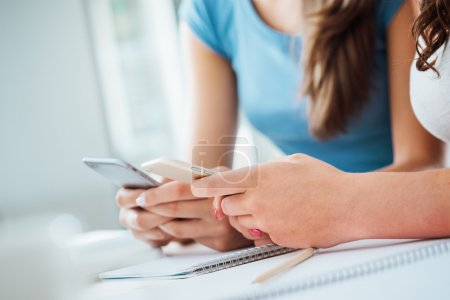 Teenager students using smart phones